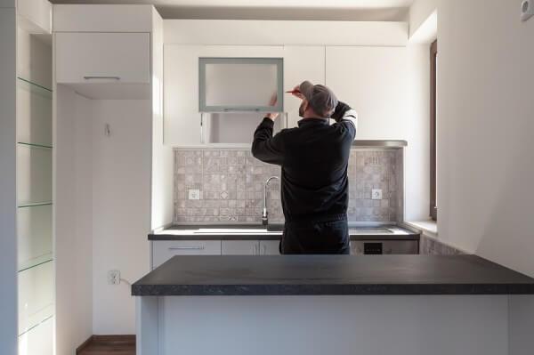 Handyman in Kitchen