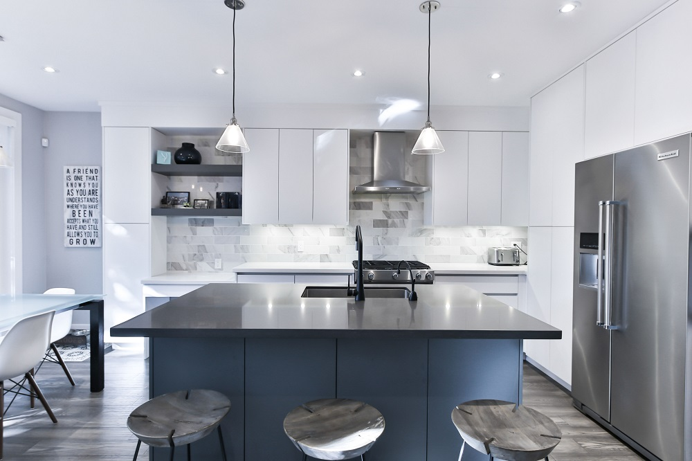 White Kitchen with White Kitchen Counters and Island
